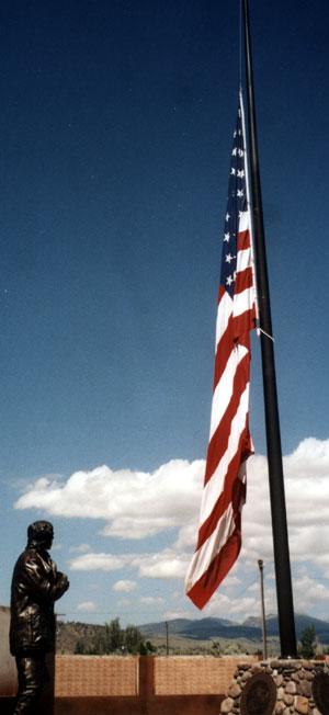 Flag half mast and cowboy