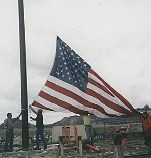 First flag raising prior to completion